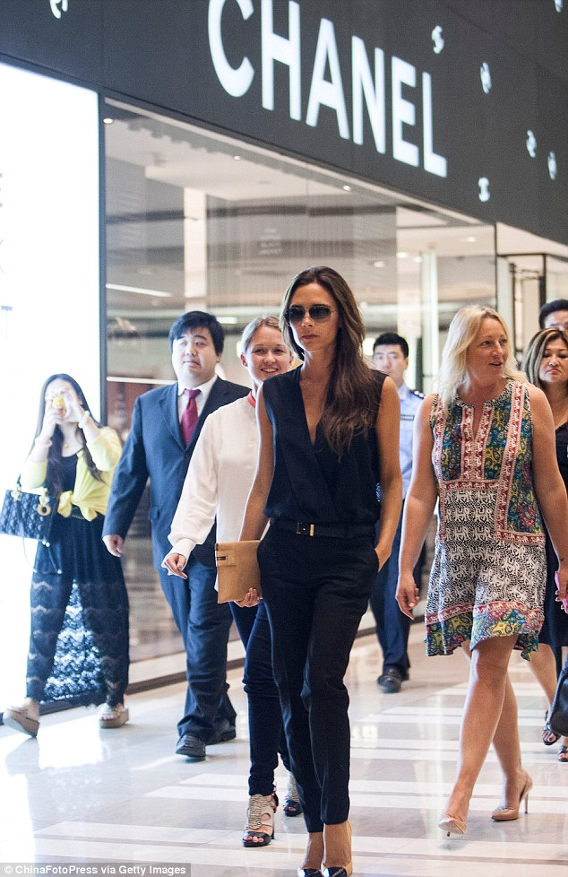 On a mission: Victoria Beckham looked amazing in all black as she arrived at Shin Kong Place in Beijing, China on Saturday