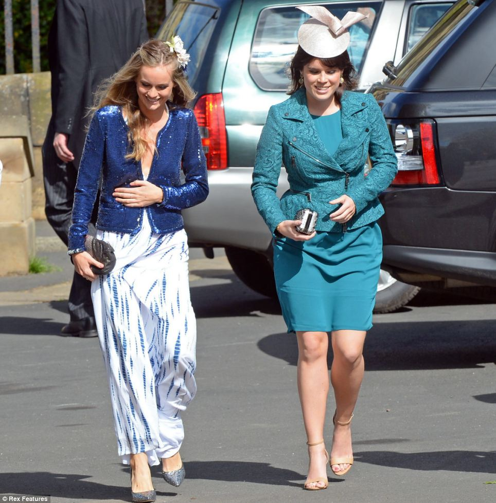 Finery: Prince Harry's girlfriend Cressida Bonas, left, wearing a blue and white maxi dress and a sequinned blue jacket, walked into the church with Princess Eugenie, who chose a green dress and co-ordinating jacket