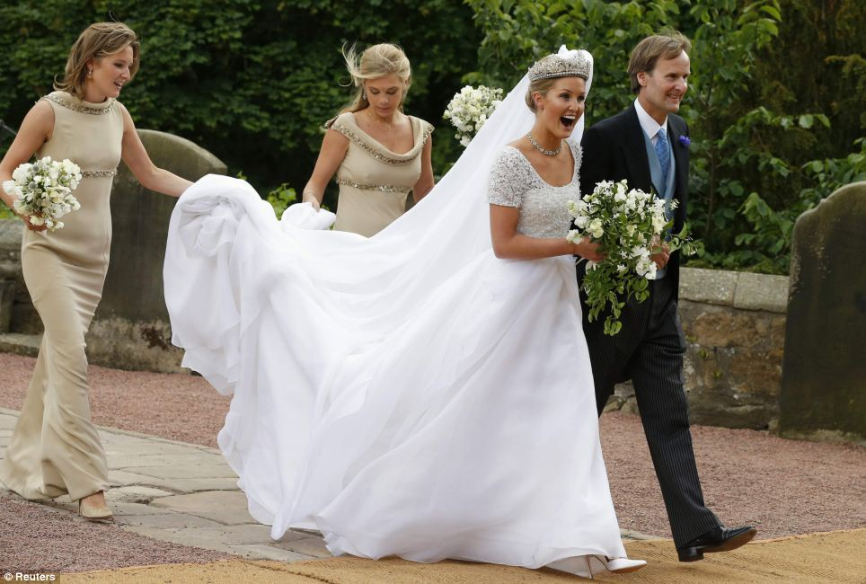 Big day: Bride Lady Melissa is accompanied by her father the Duke of Northumberland and two bridesmaids - including Prince Harry's ex Chelsy Davy (right) - as she makes her way into St Mary's Church in Alnwick