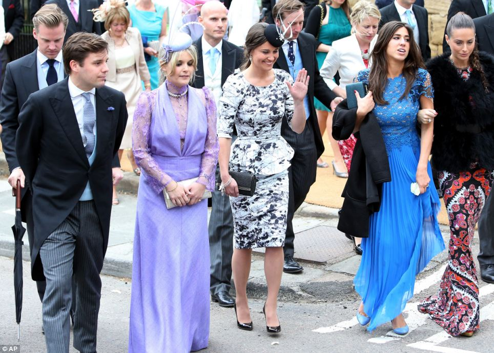 Dressed in their finest: Pippa Middleton, centre, leaves after attending the wedding, accompanied by other glamourous-looking guests