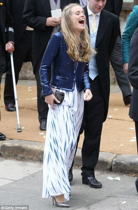 Prince Harry braves the rain, while his girlfriend Cressida Bonas seemed in a sunny mood, laughing out loud after the service