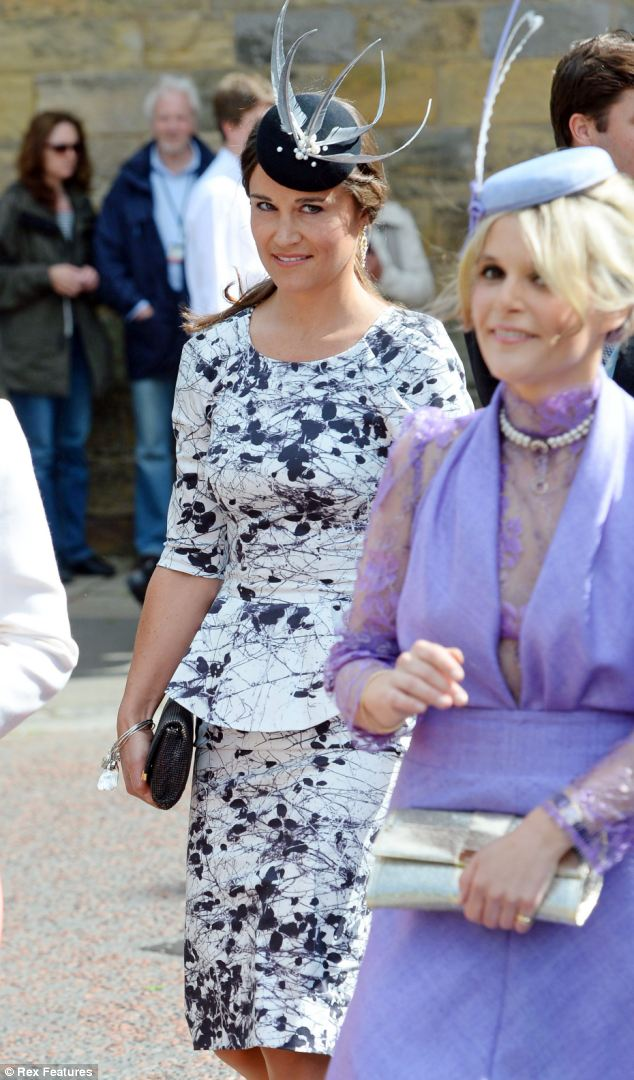 Demure: Pippa's knee-length dress had a high-cut scoop neck and elbow-length sleeves