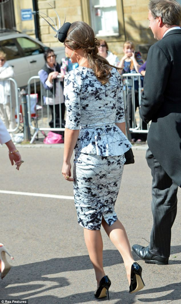 Pretty: Pippa showed off her famous posterior in the peplum dress