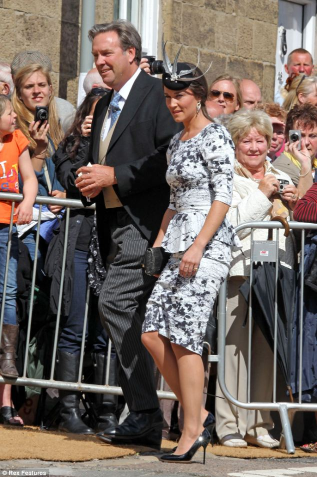 Well-wishers: Crowds filled the streets to watch the guests walk from the castle to the parish church for the wedding