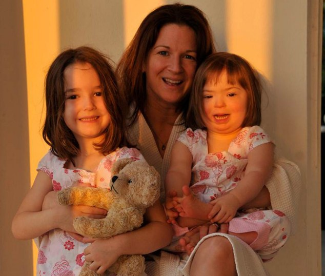 Light of our lives: Hayley Goleniowska, 43, whose daughter Natty, right, was born with Down's Syndrome
