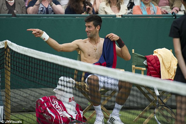 Cover up: Djokovic challenges Grigor Dimitrov to a strip tease an an exhibition match at The Boodles, before assisting ground staff at Wimbledon (below)