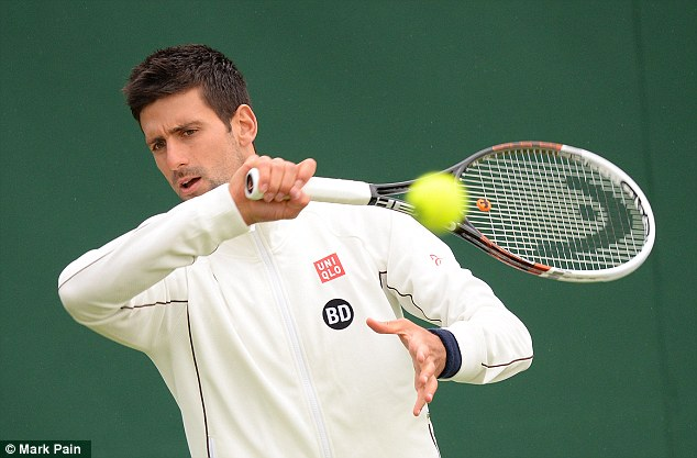 All set: Djokovic's warm up for his assault on Wimbledon was interrupted by the rain