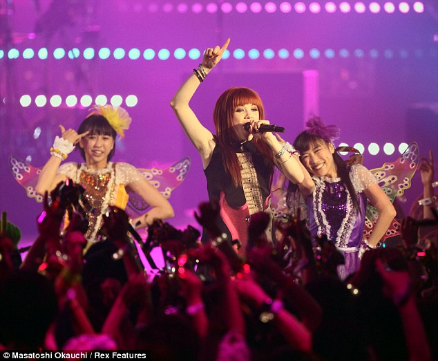 Winged companions: Carly performed alongside girl-group Momo Kuro the Makuhari Messe