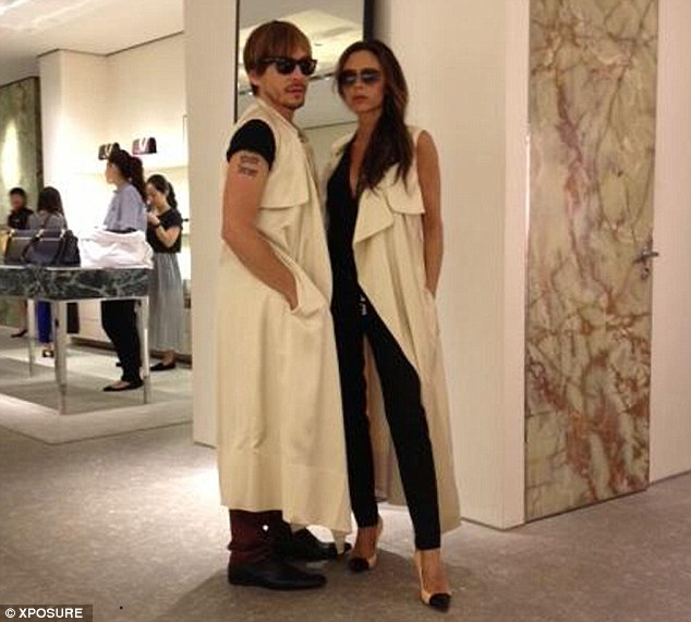 Who wore it best? Victoria tweeted another shot of herself and Paves sporting similar styles