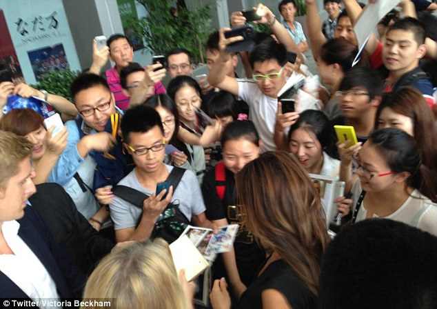 Welcome to China! Victoria posted another photograph of herself being mobbed by fans