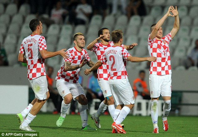 On target: Croatia players celebrate taking the lead against Uruguay in a Group F encounter