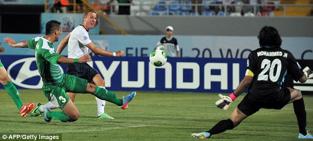 Denied: England's Harry Kane sees a shot saved by Iraq's Ali Adnan