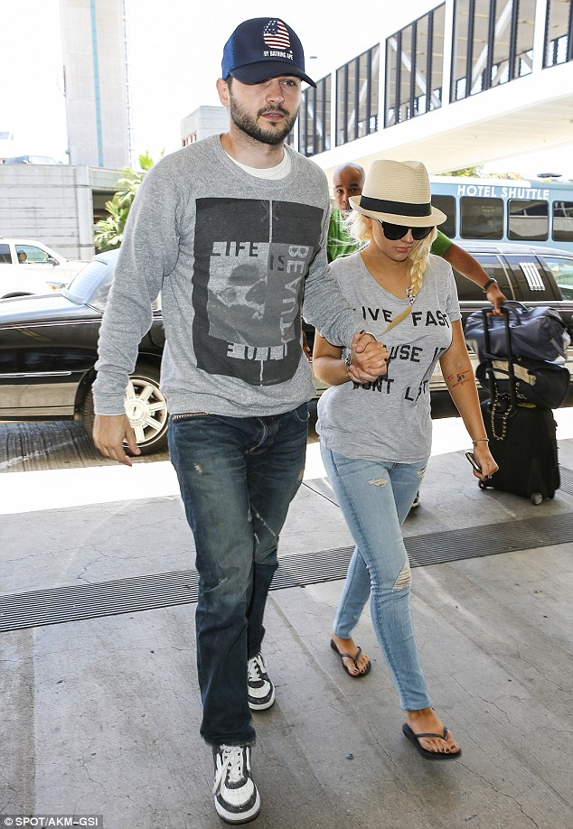 It's a match: The couple sported the same style in fashion as seen in the faded jeans and grey shirts