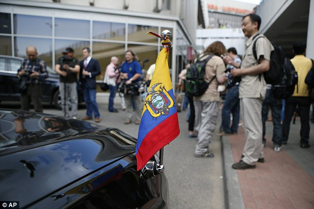 Safe haven: Journalists stand next to the Ecuadorian Ambassador's car while waiting for Edward Snowden at Sheremetyevo airport