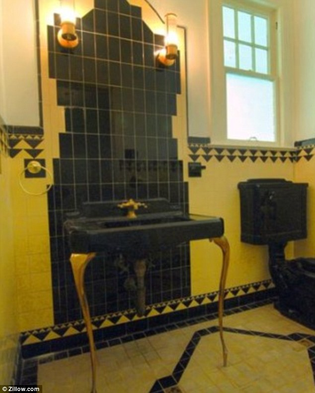 Restored: One of the house's powder rooms is still in it's original Art Deco style