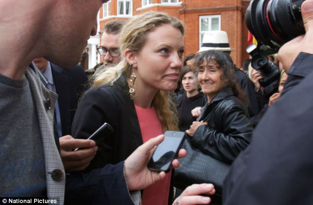 Spokeswoman: Miss Harrison became close to Assange when she started working at WikiLeaks and is believed to have acted as his assistant