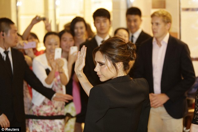 Promotion: The Spice Girl turned fashion mogul waved to fans outside Lane Crawford at the Yintai Centre in Beijing