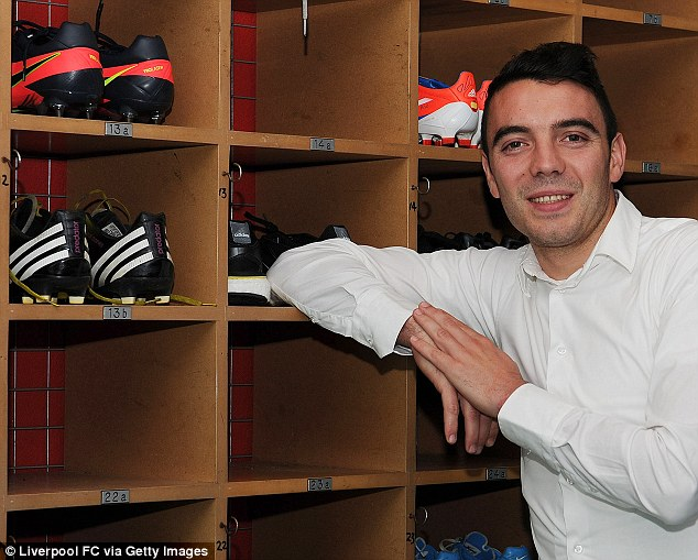Grand tour: Aspas poses in the famous Anfield boot room, and meets managing director Ian Ayre (below)