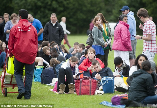 Cold: Fans in the queue expressed similar optimism as they warmed their hands on steaming cups of coffee