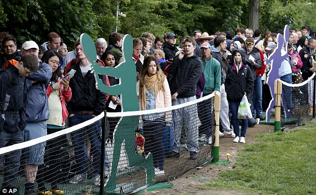 Waiting: Members of the public queue to enter the grounds on the first day of the tennis championships