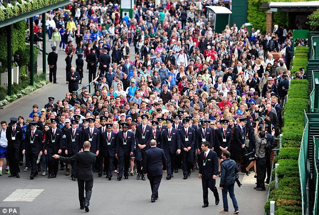 Here we are: Stewards lead crowds into the grounds at the start of day one of the Wimbledon Championships