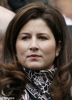 Mirka Federer, wife of Roger Federer of Switzerland, sits on Centre Court to watch her huband play Victor Hanescu of Romania in their men's singles tennis match at Wimbledon