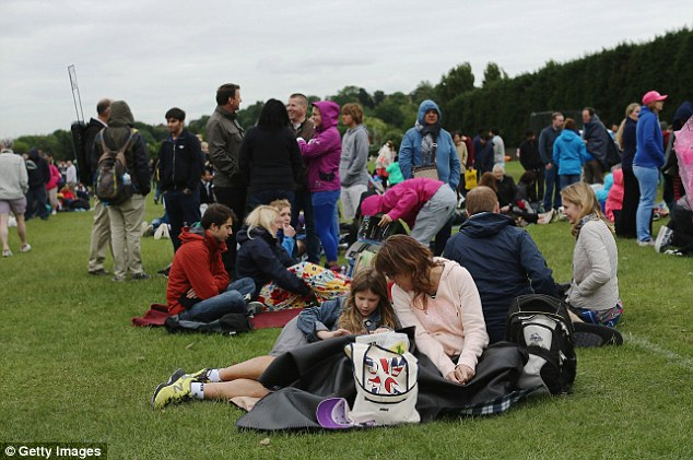 Keeping busy: Fans queue for entry into the grounds on day one of the Wimbledon Championships in London