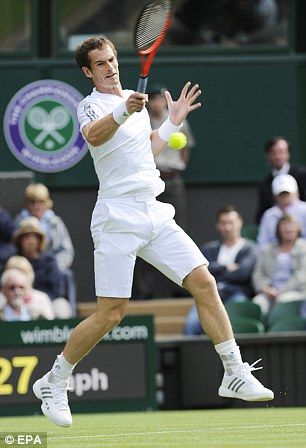 Andy Murray of Great Britain plays a backhand during his men's singles first round match against Benjamin Becker of Germany