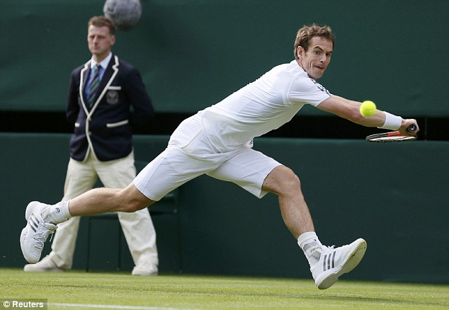 Leaping: Andy Murray hits a return to Benjamin Becker of Germany during their men's singles tennis match