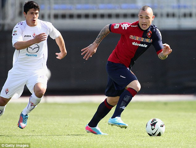 Target? But Cagliari's Radja Nainggolan (right) is one of the players that Pochettino cooled rumours on