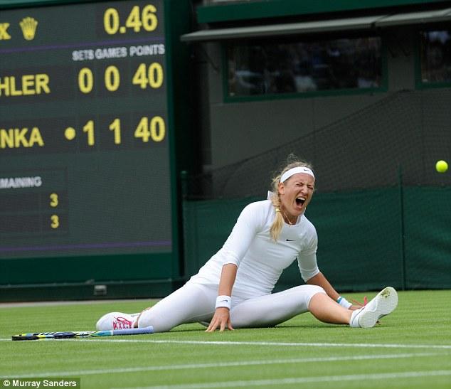 Painful: Victoria Azarenka slipped over on the baseline against Maria Joao Koehler