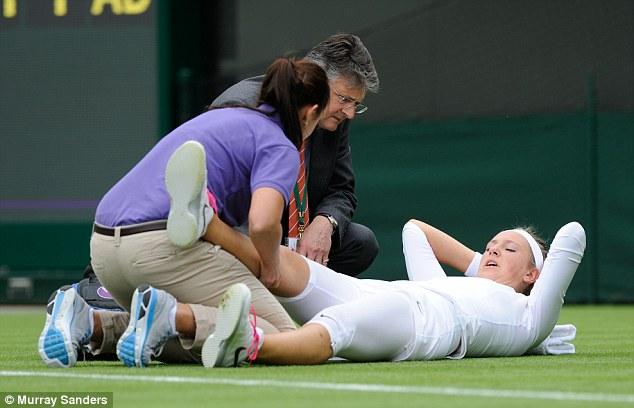 Assistance: Azarenka receives treatment on the ground