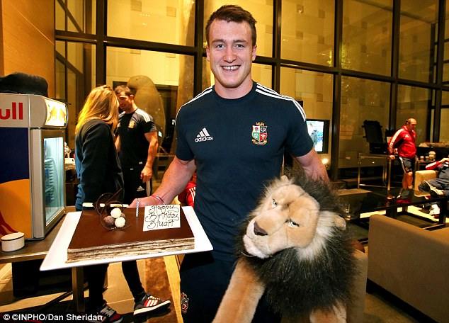 Special day: Stuart Hogg was presented with a cake for his 21st birthday on the Lions tour