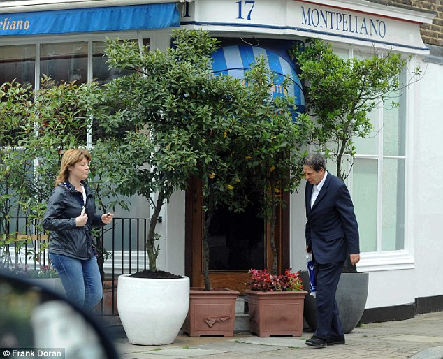 Under pressure: Charles Saatchi is pictured today. He is pictured outside a restaurant were he bought food from