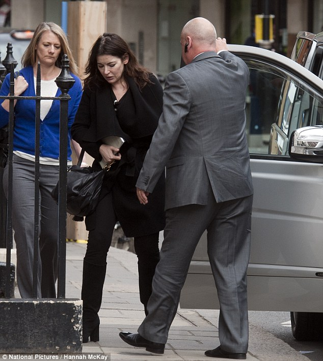 Plans: Nigella Lawson could soon fly out to America in an attempt to escape the media spotlight surrounding her marriage to Charles Saatchi. She is pictured today returning to her Mayfair address