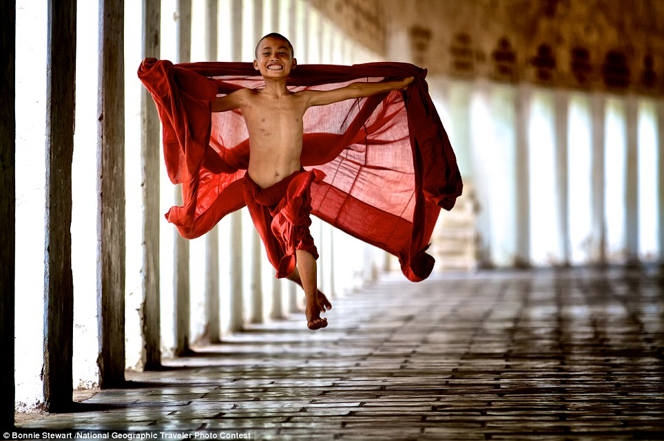 """Flying Monk: Young monks begin their service very early in life in their studies in the monastery.  This monk was young and energetic and decided to """"fly"""" in his exuberance for life"""