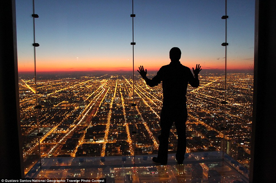 If Only I Could Fly: Spontaneous moment captured contemplating a beautiful and colorful sunset with all city lights down below
