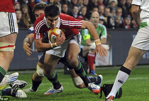 Perfect start: Conor Murray spins over the line to score for Warren Gatland's side on Tuesday