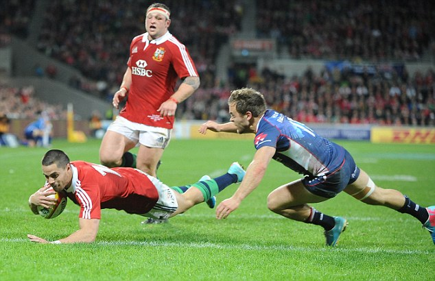 Over the line: Sean Maitland scores the Lions second try of the day against the Rebels