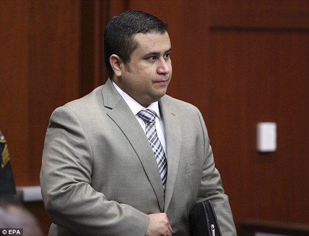 Day two: Defendant George Zimmerman enters the courtroom for his trial in Seminole circuit court where the legal teams argue if previous 911 calls should be used as evidence
