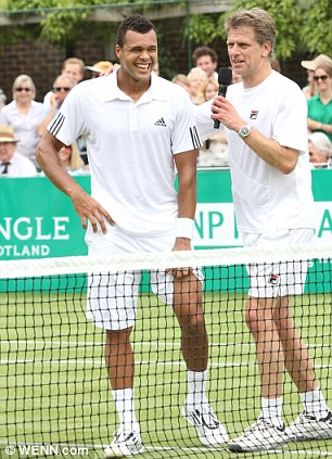 Andrew Castle, seen here with Jo-Wilfried Tsonga at the BNP Paribas Tennis Classic at London's Hurlingham Club last week