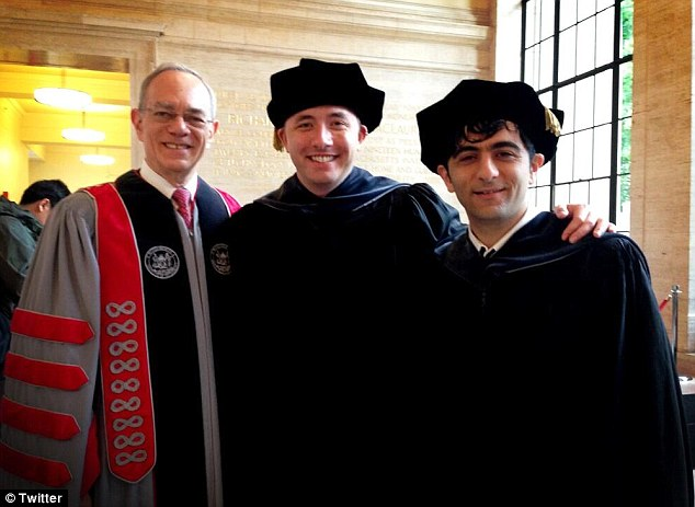Glad to be back: Drew Houston (center), gave the speech at his Alma Mater, MIT to this years graduating class