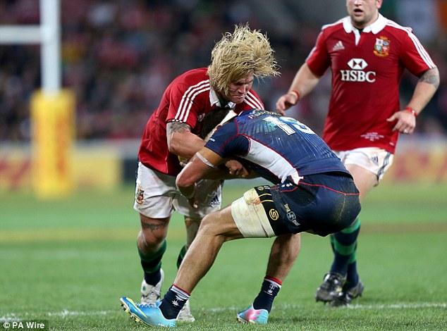 Blonde ambition: Richard Hibbard breaks a tackle