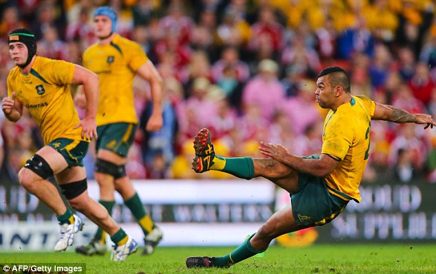 Going down: Beale slips in Brisbane to hand victory to the touring Lions