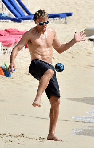 Can't resist: Phil Neville playing football