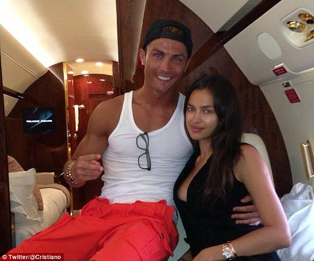 Cabin cool: Cristiano Ronaldo and his girlfriend Irina Shayk sitting in what appears to be a private jet