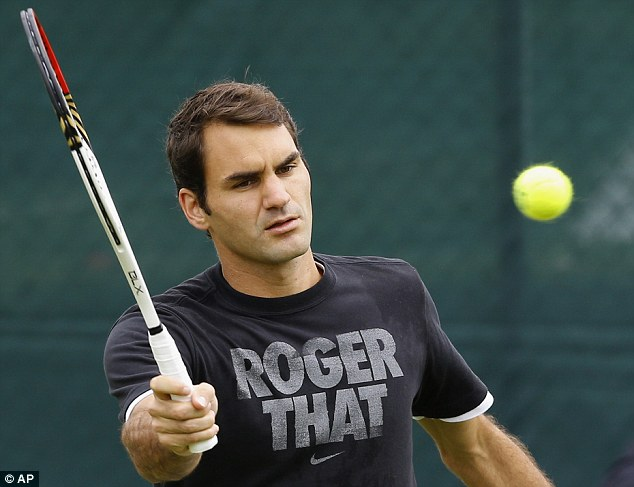 Personal: The quirky T-shirt Federer warmed up in yesterday is on sale for £20
