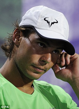 Individuality: Spain's Rafael Nadal's logo is of a Spanish bull but the T-shit made in his honour turned out to be too true given he won at the French Open on clay but crashed out on Wimbledon's grass in the first round