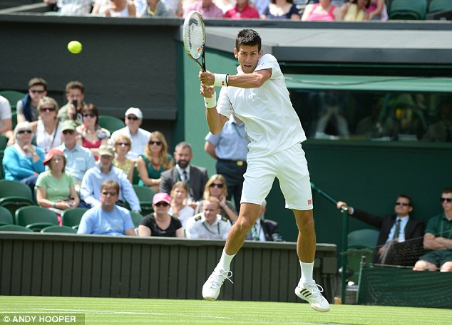 Djokovic models his 'classic white' kit on centre court today