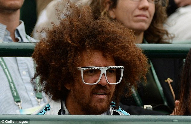 In attendance: Redfoo watches his girlfriend Victoria Azarenka earlier in the second day